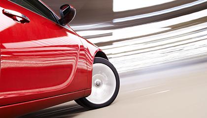 Red car turning